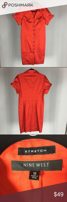 Nine West Red Button Down Dress This is a Nine West, red dress that you can button down in the front. The details of pockets and on the sleeves make this dress very interesting. The material is flattering and holds its shape. Nine West Dresses