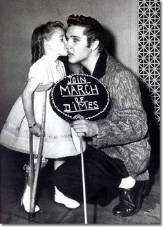 I just had to pin this!  Elvis Presley with Joanne Wilson, New York's March of Dimes girl, 1957-Proud to be a part of the March!