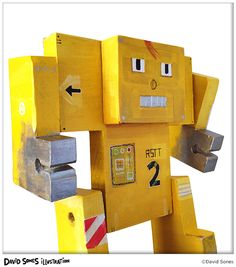 Wooden Robot Art. Yellow construction robot, with removable arms, legs, and face-plate, by David Sones.