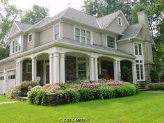 colors---love the stone & the planters. Dreamy wrap around porch.
