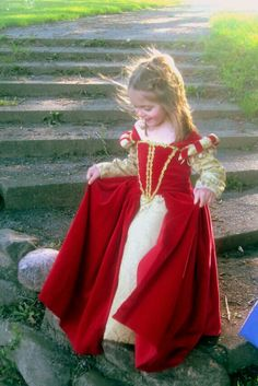 Pretty little Princess in her royal red costume.