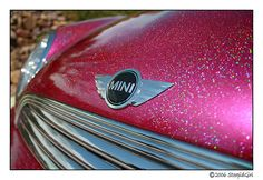 """https://flic.kr/p/oNc1d   sparkly2   can anyone guess how many pounds of metal flake were added to my car? lol  She ha a flop paint job with 4 coats of candy pink with metal flake...and then I think there's a clear coat. Someone walked by her the other days and was like """"Whoa, there's a lot of paint on that car."""" I giggled"""