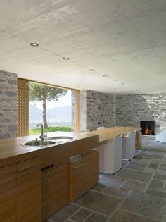 Kitchen, Dining and Living...all in one uncluttered space!  Brione House / Wespi de Meuron