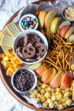 Cut up some apples and lay out your desired toppings to make an inviting Caramel Apple (Fall) Charcuterie board! Great idea for harvest parties or for kids.