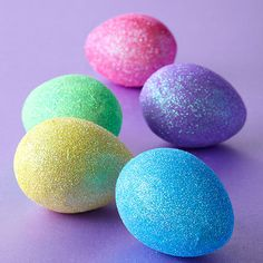 Add a little sparkle to your Easter! To make this easy Easter egg idea, simply mix glue with glitter that matches your dyed egg and paint on with a small paintbrush: http://www.bhg.com/holidays/easter/eggs/quick-and-easy-easter-egg-decorations/?socsrc=bhgpin032914glittereastereggs&page=9