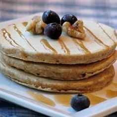 A combination of whole wheat flour, oats, cornmeal, and flaxseed flour give these pancakes lots of flavor.