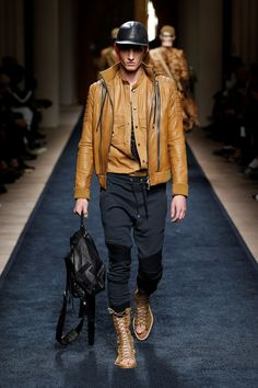 Balmain Spring 2016 Menswear Fashion Show: Caramel Leather jacket, slim fit  jeans, boots.