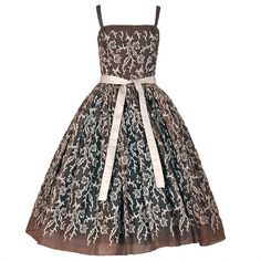 Preowned 1954 Traina-norell Embroidered Leaves Motif Mocha... ($2,900) ❤ liked on Polyvore featuring dresses, vintage, ballerina dresses, black, polka dot skater skirt, print dresses, plunge dress, embroidered dress and vintage couture dresses