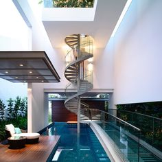 Spiral Staircase Above a Pool in a Singaporean Home – Fubiz™