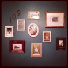 Vintage gallery wall- I used old photos of my grandparents and family members in mixed frames. I also had picked up old address numbers on our anniversary trip & added them in.
