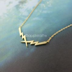 Electra Lighting Bolt Necklace in gold or silver by applelatte, $15.00