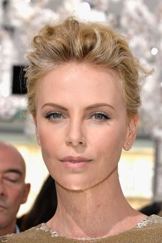 Charlize Theron attends the Christian Dior show as part of Paris Fashion Week - Haute Couture Fall/Winter 2014-2015 on July 7, 2014 in Paris, France.