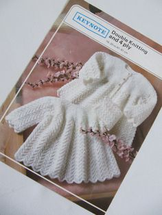 One vintage knitting pattern for a dress for babies. Produced by Keynote pattern number W417. #knitting #babyknittingpatterns #vintageknitting