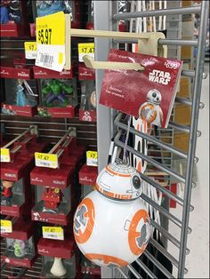 Angled Grid Wing Walls are an unusual feature of an Endcap Hallmark Christmas Ornament Display. Prime selling space, the WingWalls field Short Plastic Scan Hooks capable of only one or two ornament… Wing Wall, Hallmark Christmas Ornaments, Hooks, Grid, Wings, Star Wars, Retail, Plastic, Concept