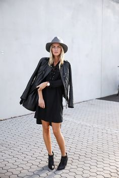 Lace up detailing adds dimension to this little... - Street Style