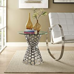 Arrange Glass Top Side Table, Silver - Coordinate your decor with the Arrange Side Table. Designed with an impressive polished steel base and tempered glass top, Arrange shines through-and-through in this side table perfect for contemporary living and lounge rooms. Set Includes: One - Arrange Side Table. Material: transparent tempered glass top stainless steel base Assembly Required. Weight: 15. Assembly Required