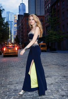 NYC meets Prom fashion in this two-piece Camille La Vie evening dress! The edgy shapes and dazzling embellishments work flawlessly together to give you the best prom look of the season! The heavily beaded one-shoulder top is bursting with sparkle along the shoulder strap and at the edge of the cropped bodice. Strut through the party with confidence and show off the bold lining of the high slit skirt