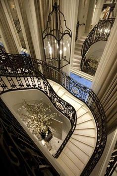 beautiful stairwell. Black handrail with gorgeous lantern style lighting