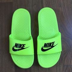 1adb5f2881e0 NIKE NEON SLIDES NWOT NIKE SLIDES. Everyone has them and you need them !  Perfect for spring and summer only tried on Nike Shoes Sandals