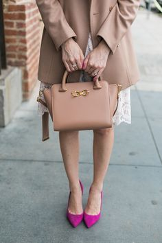 camel coat with bow bag and pink heels by M Loves M