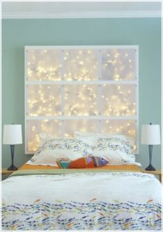 How to Decorate a Marvelous and Sophisticated Interior Bedroom for Christmas : Yellow Light On The Blue Wall Also White Bed And Pillows Also Red Pillows Two White Pendant Lamp