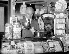Football manager/player raich carter, serving in his sweet shop in George Street, Hull.