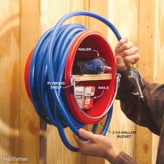 A 2-1/2-gallon bucket is all you need to store air tools and hoses on a wall right by the air compressor. Screw a 3/4-in. plywood shelf inside the bucket to create two storage areas, then attach the bucket to the wall with a couple of screws and washers. Load up the bucket with nailers, nails, tire pressure gauges and other accessories and coil the hose around it.