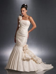 A mermaid wedding gown with one floral strap.