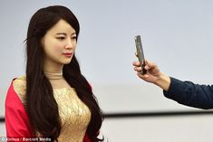 Hello everyone, I'm Jia Jia. Welcome!' the robot said as it greeted the audience at the university's multi-media center today, reports Xinhuanet. 'Don't come too close to me when you are taking a picture. It will make my face look fat,' Jia Jia said.