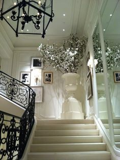 Ralph Lauren NYC. A must see! Haute Indoor Couture. Love the mirrors up the stairs.