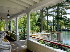 This porch in Maine is the epitome of Yankee opulence: solid materials and a lovely view of nature. No further adornment is needed.