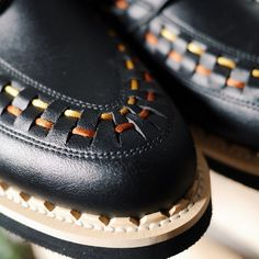 """Our TRF shoes are made with a 100% impermeable, breathable, antibacterial but soft and light leather alternative. The sole is made from a lightweight, but tough, EVA, and the interlacing runs (unusually) all the way around the shoe. They're made in England. By Story mfg. British """"Slow Made"""" Wear."""