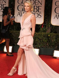 Who says slits can't be sweet? Not Charlize Theron who stepped out in an etherial pastel pink Dior confection at the 2012 Golden Globes.