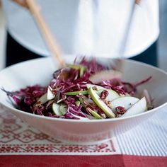 Red Cabbage, Cranberry, and Apple Slaw   The slaw marinates in the refrigerator for a couple of hours, allowing the vinaigrette to permeate the cabbage and plump the cranberries. Stir in apples just before serving to keep them bright.