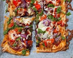 This lighter version of pizza is made with filo pastry and topped with onion, pepper, tomatoes and a homemade pesto