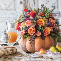 For a showstopping focal point, present a profusion of flowers in a pumpkin. Find 5 more of our favorite ideas for decorating with pumpkins on our site!