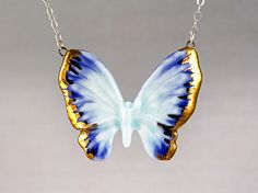 Gilded Butterfly pendant necklace, porcelain and 24 carat gold luster with sterling silver chain in blue on Etsy, Sold