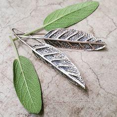 Hand fabricated botanical jewelry. Nicole Ringgold.