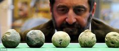 Project Officer Battlefields Trust Glenn Foard looks at a collection of cannon balls found at the site of the Battle of Bosworth Field in Leicestershire