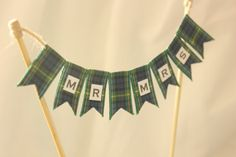 Top your cake with tartan bunting. | 26 Impossibly Beautiful Scottish Wedding Ideas