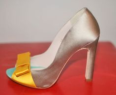 Taupe shoes with yellow bows. Aww.