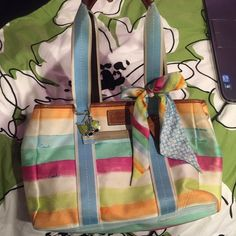 Watercolor coach bag Watercolor coach bag. Used but not abused. The material is easy to get dirty but I'm sure it can be cleaned. I just never have. 100 percent authentic. Comes with matching scarf. Key ring not included Coach Bags