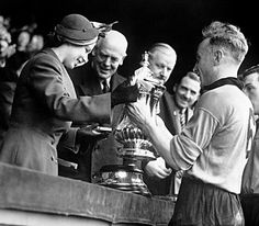 Princess Elizabeth (later The Queen) presents the Football Association Cup to Billy Wright, captain of Wolverhampton Wanderers, after Wolverhampton defeated Leicester City in the FA Cup Final at London's Wembley Stadium, March 1949.© Press Association