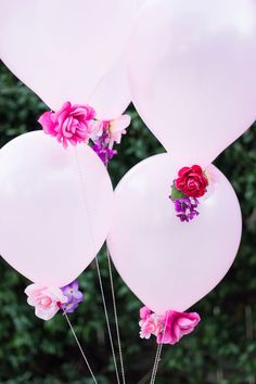 Need pretty decor in a pinch? Give a bunch of balloons an extra oomph by adding a cluster of fake flowers to the bottom.  Get the tutorial at Design Improvised.   - CountryLiving.com
