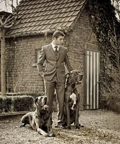 just a man, in his suit, with his dogs . . . prolly my future lol
