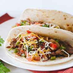 Simplify a hectic day with the convenience of this easy slow cooker recipe that is packed with Southwestern flavor. The tender mixture of shredded beef, onion, peppers and tomatoes with chiles is rolled inside warm flour tortillas for serving. Photo credit: Jen Tilley from How to Simplify.