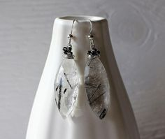 Tourmalinated quartz earrings rutilated by ArtfulHummingbird.  $95.00.  http://www.artfulhummingbird.etsy.com.