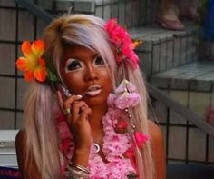 """Ganguro, literally """"black-face,"""" is a Japanese fashion trend popular with many Japanese girls, which peaked in popularity from the late 1990's to the early 2000's as an outgrowth of chapatsu hair dyeing. The basic look consists of bleached hair, a deep tan, both black and white eyeliners, false eyelashes, platform shoes (usually sandals or boots), and brightly colored outfits."""