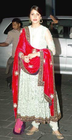 Anushka Sharma in a red velvet dupatta along with her Anarkali dress at Shirin Morani's wedding reception.