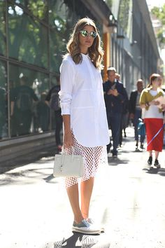 Milan street-style: Anna Fasano added some interesting texture to her monochromatic, white-on-white ensemble outside Emporio Armani with a modern mesh skirt and metallic oxfords.